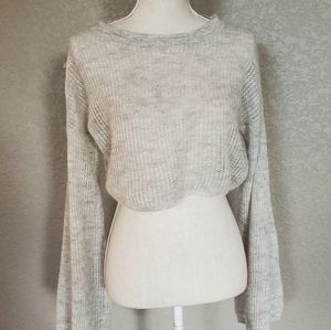Sleeping on snow cropped bell sleeve sweater